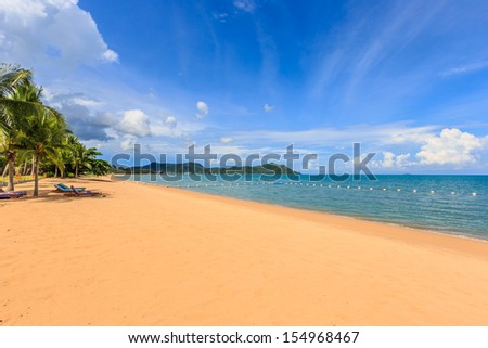 line of white buoy with coconut trees and moutain at pattaya beach - stock photo