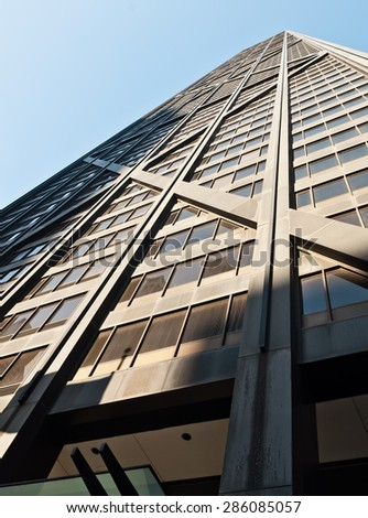 Line pattern of windows on a high-rise building on a sunny day - stock photo