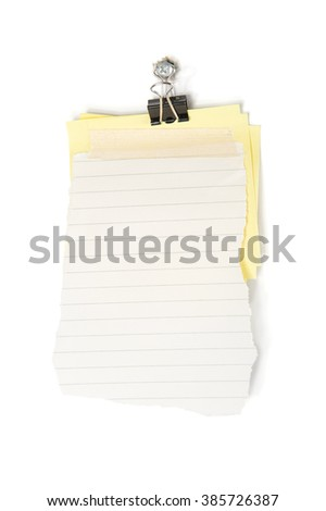 Lined note paper taped on sticky note with paper clip hanging on nail. - stock photo