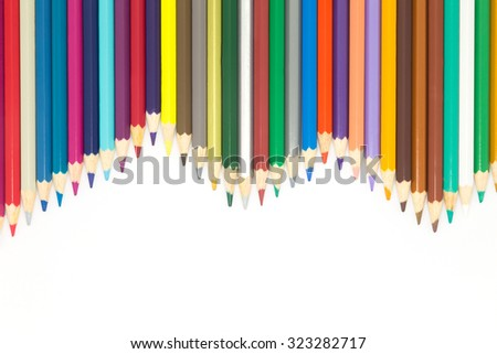 Lined of multiple colours wooden pencils on white background - stock photo