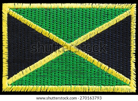 Linen fabric patch of the jamaican flag - stock photo