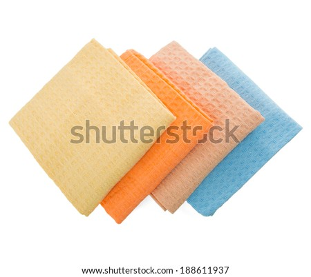 Linen napkins folded in the shape of a rhombus on a white background - stock photo