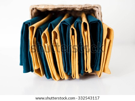 Linen napkins stack isolated in storage box - stock photo