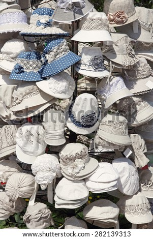 Linen white hats for sale taken closeup. - stock photo