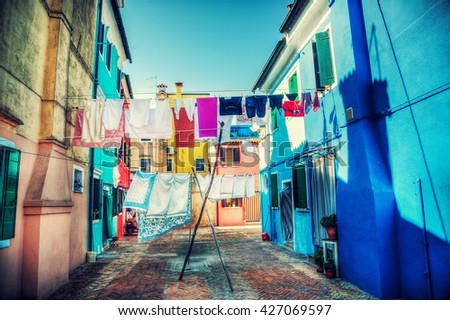 Linens drying outdoors on Venice Italy street. Vibrant hdr style colors. - stock photo