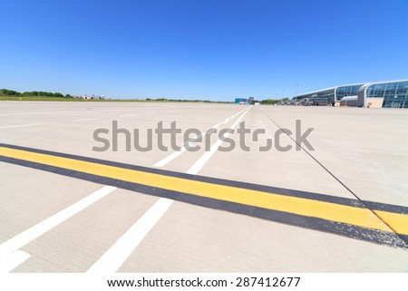 lines and shadows on the runway in airport - stock photo