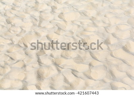 Lines in the sand of beach, close up - stock photo