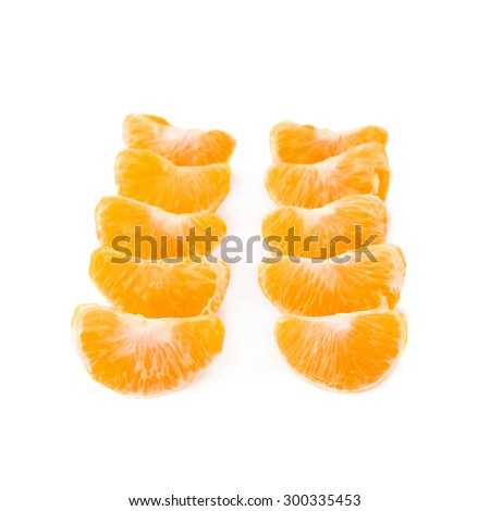Lines of slice sections of ripe tangerine isolated served over the white background - stock photo