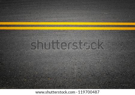 lines of traffic on paved roads background - stock photo