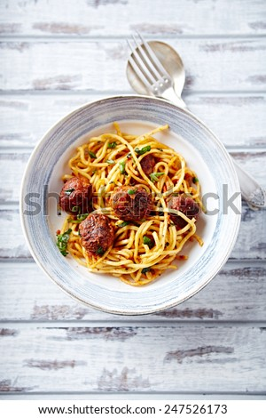 Linguine with meatballs, tomato sauce and parsley - stock photo