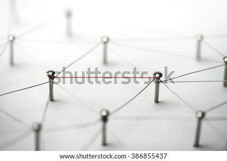 Linking entities. Hotline, high bandwidth.  Network, networking, social media, connectivity, internet communication abstract. Single red wire in a web of silver wires on white background. - stock photo