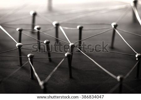 Linking entities. Network, networking, social media, internet communication abstract. Web of wires on wood. Monotone or Black and White.  - stock photo