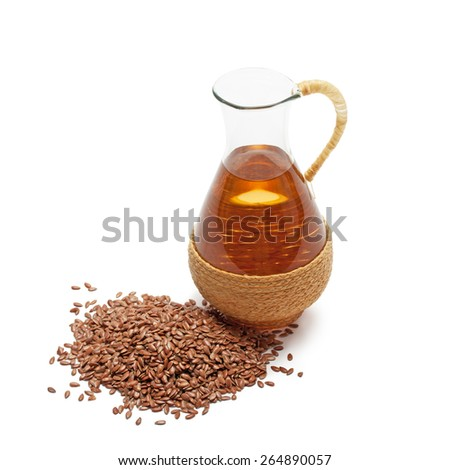 linseed oil with flax seeds isolated on white - stock photo