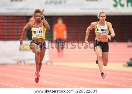 LINZ, AUSTRIA - JANUARY 30, 2014: Carina Horn (#409 Republic of South Africa) wins the women's 60m event in an indoor track and field meeting. - stock photo