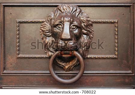 Lion door knocker - stock photo