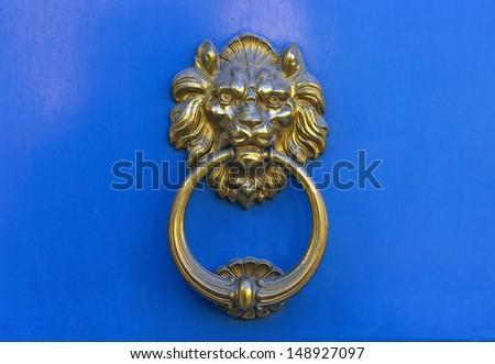 Lion Door Knocker at Paris, France - stock photo