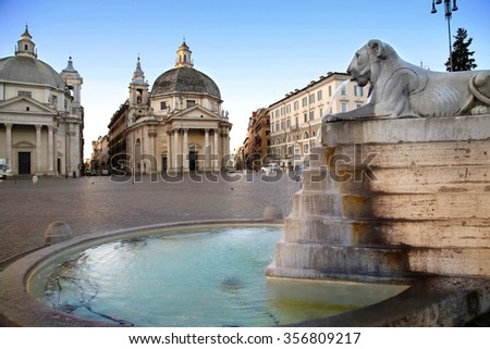 Lion fountain in Piazza del Popolo ( View of Santa Maria in Montesanto and Santa Maria dei Miracoli ) in Rome, Italy ( photographed very early in the morning ) - stock photo