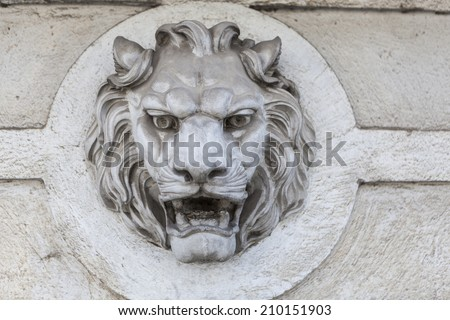 Lion head building exterior wall sculpture decoration - stock photo