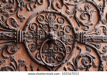 Lion head on vintage door (Notre Dame de Paris) - stock photo