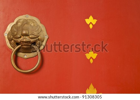 lion knocker on the chinese traditional red door - stock photo