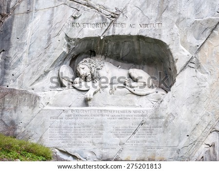 Lion Monument (Lewendenkmal), a historic landmark (1821) in Lucerne, Switzerland, was carved in the rock to honor the Swiss Guards of Lois XVI of France  - stock photo