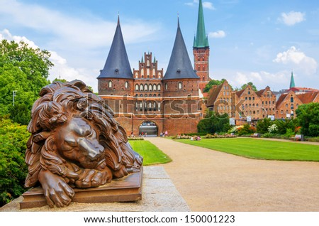 Lion statue beside Holstein Gate at Lubeck. Germany - stock photo