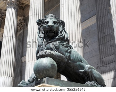 lion statue entrance to Congress of the Deputies Madrid Spain government buildng  - stock photo