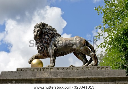 lion statue on Royal Avenue (copies of the late 16th century Italian Medici lions in Florence) in Bath, Somerset, England - stock photo