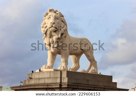 Lion statue on Westminster bridge, London - stock photo
