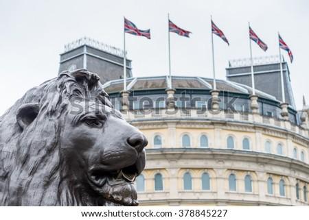 Lion Statue with British Flags, Trafalgar Square, London - stock photo