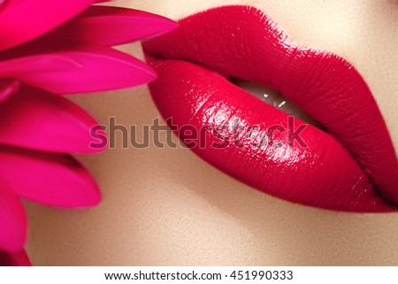 Lip gloss. Pink lipstick. Nice full lips with pink lip makeup. Fashion makeup. Beauty and spa salon. Close-up of a beautiful sexy red lips. Sexy lips. Part of woman's face with clean skin - stock photo