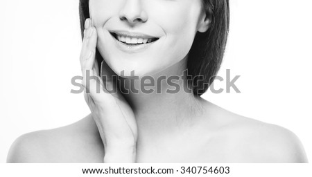 Lips hand smile teeth Woman face young beautiful healthy skin portrait black and white  - stock photo