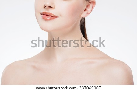 Lips neck nose Beautiful woman face close up portrait young studio on white    - stock photo