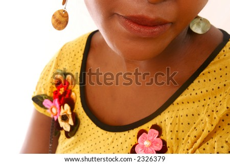 Lips of a Black  female model in a yellow top.  Shallow D.O.F ? Lips in focus, rest of body out of focus. - stock photo