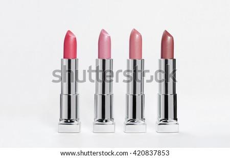 lipstick on a light background - stock photo