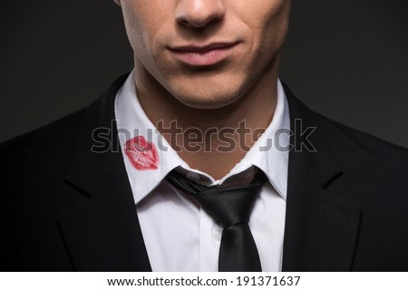 Lipstick on your collar. Man with lipstick on his collar - stock photo