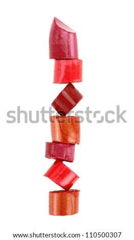 Lipstick stack on white background - stock photo