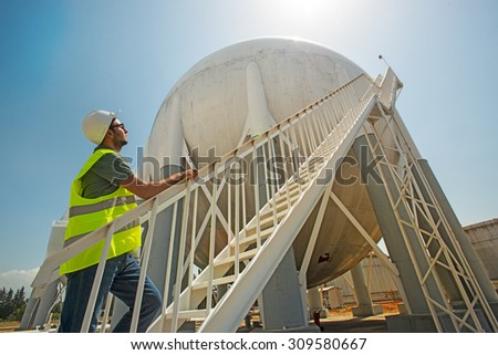 Liquefied Petroleum Gas tanks and Petrochemical Engineer - stock photo