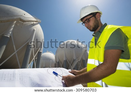 Liquefied Petroleum Gas tanks and Petrochemical Engineer. petrochemical engineer preparing the project of  fuel tank - stock photo