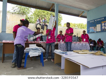 LIQUICA, EAST TIMOR - JULY 7, 2012: Uniformed polling staff  counting votes at East Timor General Elections in 2012 - stock photo