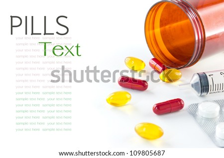 Liquid capsules and pills spilling out of bottle on white background - stock photo