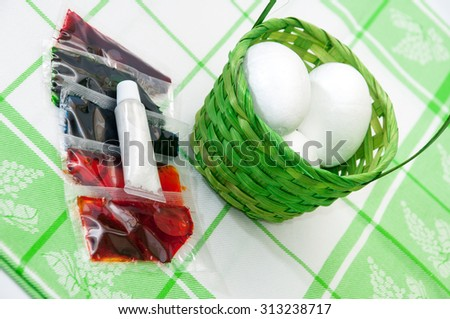 Liquid colors for coloring Easter eggs and fake eggs made of styrofoam. - stock photo