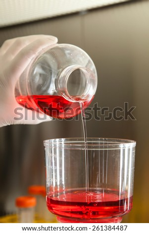 liquid falling pipette in laboratory - stock photo