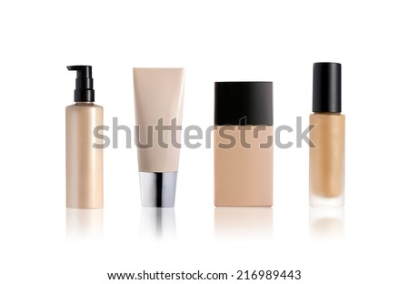 Liquid foundation containers isolated on white - stock photo