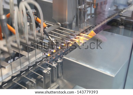 Liquid inject-able filling line in a Pharmaceutical industry - stock photo