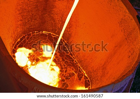 Liquid metal from blast furnace - stock photo