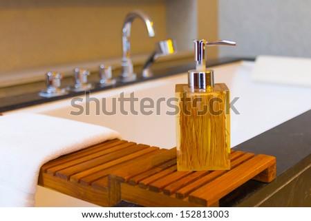 Liquid soap bottle on the bathtub in modern bathroom - stock photo