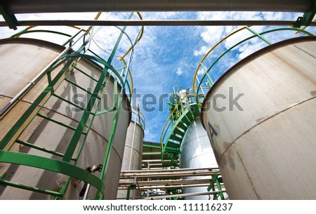 liquid tanks in tetrochemical plant - stock photo