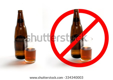 Liquor bottles and glass of liquor and stop sign on white background - stock photo