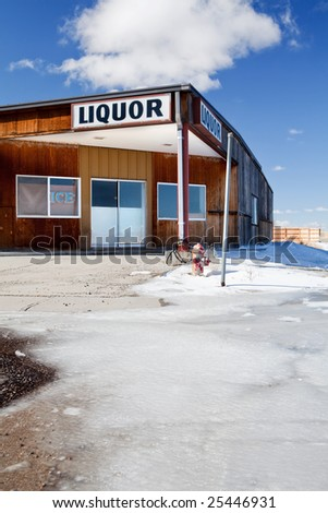 liquor store in winter - closed and long abandoned, Wyoming - stock photo